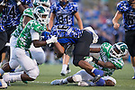 Donshel Jetton (6) of the Mooresville Blue Devils is tackled by Brandon Dry (left) and Cinsere Allison (right) during first half action at Coach Joe Popp Stadium on September 9, 2016, in Mooresville, North Carolina.  The Blue Devils defeated the Wonders 23-21.  (Brian Westerholt/Special to the Tribune)