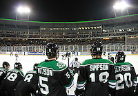 The view from the North Dakota bench during the first period. North Dakota beat Nebraska-Omaha 5-2 in the outdoor game at TD Ameritrade Park on Saturday, Feb. 9, 2013. (Photo by Michelle Bishop)