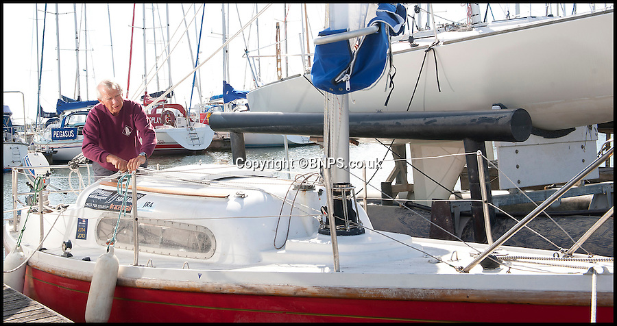 BNPS.co.uk (01202) 558833<br /> Picture: LauraJones/BNPS<br /> <br /> Grandad Edward Hooper is celebrating after setting a new record in a yacht race around the Isle of Wight - for the longest time ever taken to finish.<br /> <br /> Tenacious skipper Edward, 73, and pal Steve Peake, 64, took a whopping 25 hours and 15 minutes to complete the 55-mile Round the Island Race.<br /> <br /> They started the historic event at 8.10am amid a fleet of more than 1,500 yachts, but due to very light winds and strong tides they didn't cross the finish line until 9.25am the next day.<br /> <br /> The fleet was plagued with a breeze of just three knots - 3.5mph - from the start of the race and more than half the crews decided to turn back after just a few hours.<br /> <br /> But tireless Edward, a retired naval officer, and construction project manager Steve decided to plod on.<br /> <br /> At one point they even had to anchor their 21ft yacht Amiina for six hours while they waited for the tides to change before continuing the race.<br /> <br /> Organisers of the J.P. Morgan Round the Island Race, held last Saturday, have confirmed Edward's result as the slowest time recorded in the modern era of the race, which first took place in 1931.