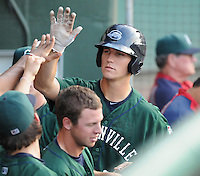 Catcher Carson Blair (18) of the Greenville Drive is congratulated after hitting a home run against the Rome Braves in a game on July 17, 2011, at Fluor Field at the West End in Greenville, South Carolina. (Tom Priddy/Four Seam Images)