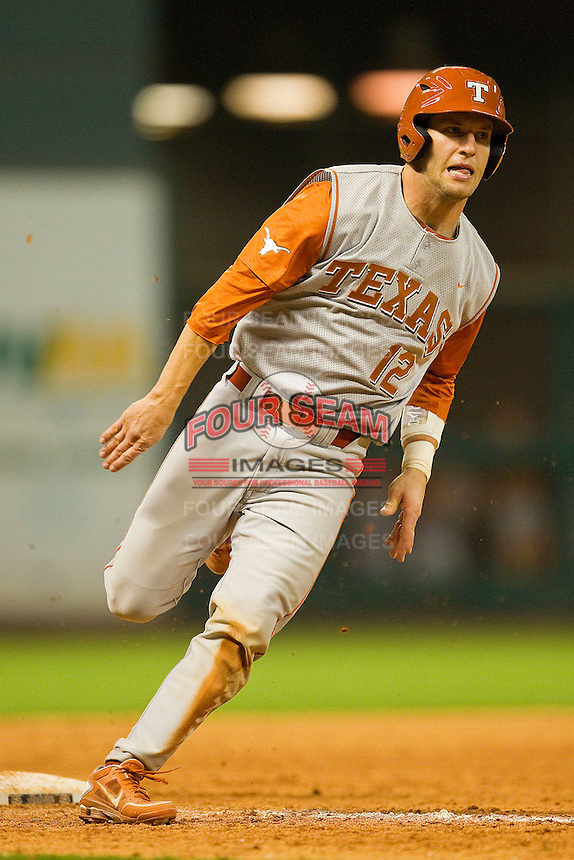 Jacob Felts #12 of the Texas Longhorns rounds third base against the Tennessee Volunteers at Minute Maid Park on March 3, 2012 in Houston, Texas.  The Volunteers defeated the Longhorns 5-4.  Brian Westerholt / Four Seam Images