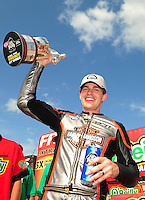 Apr. 29, 2012; Baytown, TX, USA: NHRA pro stock motorcycle rider Andrew Hines celebrates after winning the Spring Nationals at Royal Purple Raceway. Mandatory Credit: Mark J. Rebilas-