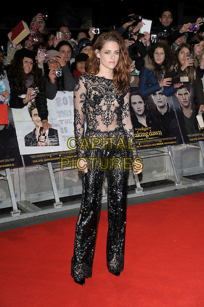Kristen Stewart (wearing Zuhair Murad).'The Twilight Saga: Breaking Dawn Part 2' European film premiere, Empire cinema, Leicester Square, London, England..14th November 2012.full length black lace sheer see through thru sequins sequined jumpsuit   .CAP/PL.©Phil Loftus/Capital Pictures.