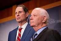 United States Senator Ron Wyden (Democrat of Oregon) and United States Senator Ben Cardin (Democrat of Maryland) at a press conference calling to save pre-existing condition protections in the health care system during on Capitol Hill in Washington D.C., U.S. on July 31, 2019.<br /> <br /> Credit: Stefani Reynolds / CNP/AdMedia
