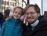 Kaleb Temple and 6-year old Sophia during the Reno Women's March on Washington event on Virginia Street in downtown Reno on Saturday, Jan. 21, 2017.