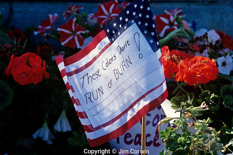 Memorial for 9/11, September 11th 2001 with flowers and American flag with writings These colors don't run or burn West Seattle Washington State uSA