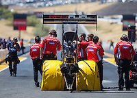 Jul 30, 2016; Sonoma, CA, USA; Crew members with NHRA top fuel driver Shawn Langdon during qualifying for the Sonoma Nationals at Sonoma Raceway. Mandatory Credit: Mark J. Rebilas-USA TODAY Sports