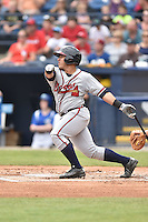 Rome Braves catcher Bryan De La Rosa (26) swings at a pitch during a game against the Asheville Tourists on May 17, 2015 in Asheville, North Carolina. The Tourists defeated the Braves 9-8. (Tony Farlow/Four Seam Images)