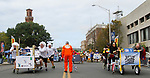 WATERBURY, CT - 08 OCTOBER 2017 -101417JW06.jpg -- The teams from MacDermid Performance Solutions starts off against the Team from Webster Bank as Dr. Peter Jacoby drops the checkered flag to start the race during the 2017 United Way Bed Race Fundraiser Saturday morning. Jonathan Wilcox Republican-American