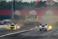 Aug. 31, 2012; Claremont, IN, USA: NHRA funny car driver Todd Lesenko (left) races alongside Blake Alexander during qualifying for the US Nationals at Lucas Oil Raceway. Mandatory Credit: Mark J. Rebilas-