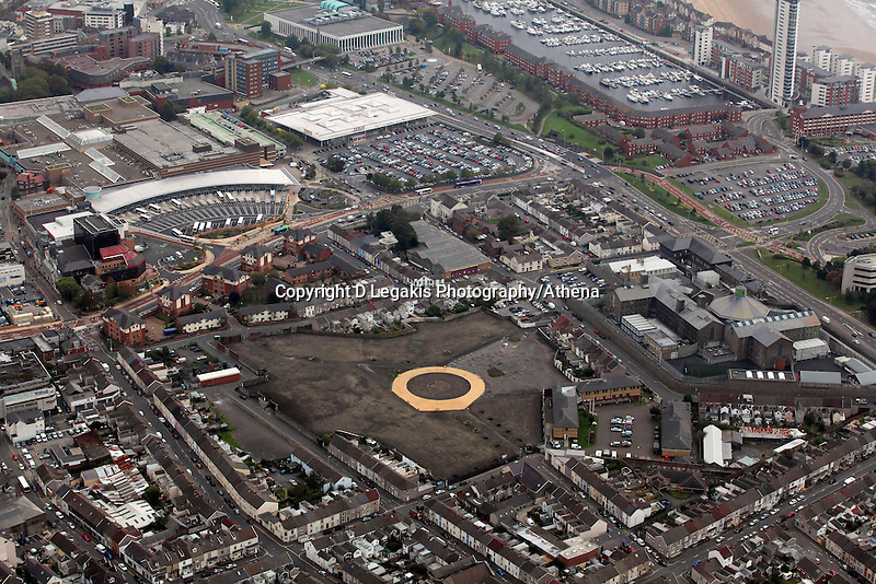 Pictured: The area where the Vetch Field, former home ground of Swansea City Football Club ground was, Quadrant shopping centre and bus station to left, Tesco Marina store top, Swansea prison right.. 16 September 2011<br /> Re: Aerial photography, Swansea, south Wales.