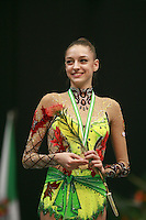 Evgenia Kanaeva of Russia smiles to fans upon winning All-Around gold at 2008 Portimao World Cup of Rhythmic Gymnastics on April 19, 2008.  (Photo by Tom Theobald).
