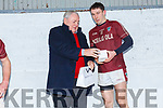 Dromids Kealan Ó Faircheallaigh receives the Man of the Match from Padraig Fogarty at the South Kerry Senior Football Championship in Ballinskelligs on Saturday.
