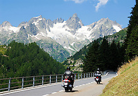 Switzerland, Canton Uri, biker at Sustenpass Road: Fuenffingerstock mountains with peaks Sustenhochspitz, Wendenhorn und Wasenhorn (f.l.t.r.)