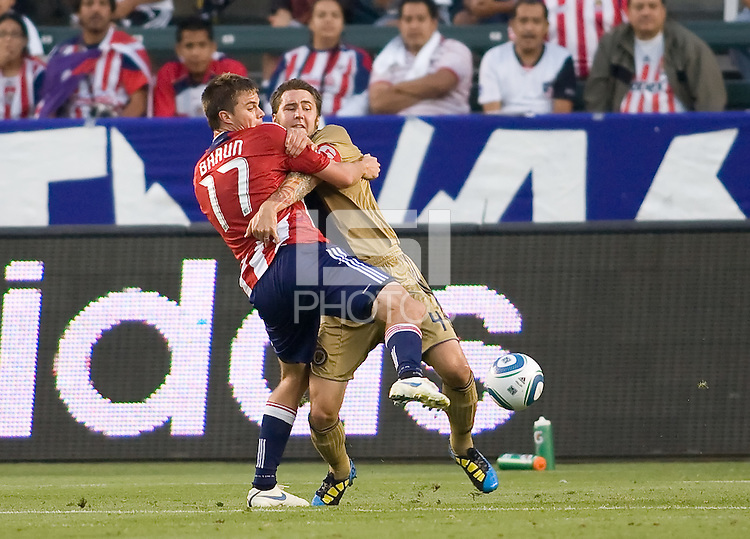 Philadelphia Union defender Danny Califf (4) wrestles with CD Chivas USA forward Justin Braun (17). The Philadelphia Union and CD Chivas USA played to 1-1 draw at Home Depot Center stadium in Carson, California on Saturday evening July 3, 2010..