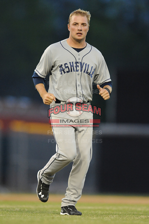 Asheville Tourists Kyle Parker #8 crosses the field between innings during a game vs. the Hickory Crawdads at L.P. Franz Stadium in Hickory,  North Carolina;  April 7, 2011.  Hickory defeated Asheville 4-2.  Photo By Tony Farlow/Four Seam Images