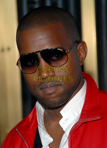 KANYE WEST.Conde Nast Media Group's Third Annual Fashion Rocks Concert at Radio City Music Hall, New York, NY, USA,.7 September 2006..portrait headshot sunglasses red jacket.Ref: ADM/PH.www.capitalpictures.com.sales@capitalpictures.com.©Paul Hawthorne/AdMedia/Capital Pictures. *** Local Caption ***