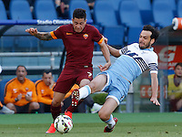 Calcio, Serie A: Lazio vs Roma. Roma, stadio Olimpico, 25 maggio 2015.<br /> Roma's Juan Iturbe, left, is challenged by Lazio's Marco Parolo during the Italian Serie A football match between Lazio and Roma at Rome's Olympic stadium, 25 May 2015.<br /> UPDATE IMAGES PRESS/Riccardo De Luca
