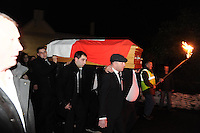 7-12-2014: Led by traditional pikemen carrying lighted turf light the remains of  Jackie Healy-Rae are carried by in front his sons Michael and Danny during the removal from his pub to to local church at 10pm in Kilgarvan in Conunty Kerry on Sunday.<br /> Picture by Don MacMonagle