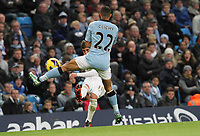 Barclays Premier League, Man City (blue) V Swansea City (white) Etihad Stadium, 27/10812<br /> Pictured: Swansea's Pablo Hernadez curls the ball around Gael Clichy<br /> Picture by: Ben Wyeth / Athena Picture Agency