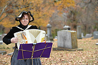 NWA Democrat-Gazette/J.T. WAMPLER Caarol Widder of Fayetteville plays accordion Sunday Nov. 12, 2017 during a History Comes Alive program at Evergreen Cemetery in Fayetteville. The two-day event  was held to raise money for maintenance and improvement projects at the cemetery that was established in 1847. It has the graves of several prominent Arkansans including the stateÕs first congressman Archibald Yell. The Evergreen Cemetery Association so far has raised about $13,000 of $22,050 needed to restore YellÕs crumbling tombstone. Actors from Artists Laboratory Theatre, a Fayetteville collective, will portray several historical figures as folks walk around the cemetery, including Archibald Yell, Roberta Fulbright, Lafayette Gregg and others.