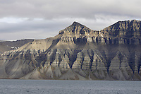 Sun lighting up mountain landscape near Longyearbyen on Spitzbergen Norway