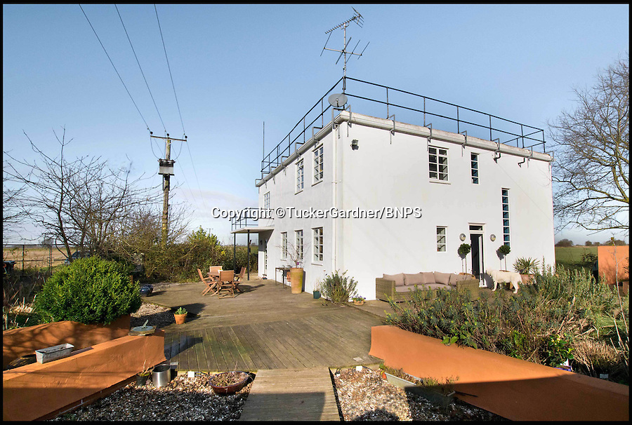 BNPS.co.uk (01202 558833)<br /> Pic: TuckerGardner/BNPS<br /> <br /> Potential buyers are scrambling to view a unique RAF control tower that has appeared on the property radar near Saffron Walden in Essex.<br /> <br /> A Second World War tower has been transformed into a stylish family home and is now on the market for &pound;775,000.<br /> <br /> Little Walden airfield in Essex was opened in 1944 and the base was home to American Mustang fighters and B17 Flying Fortresses throughout the war.<br /> <br /> It is now a four-bedroom home with a wrap-around balcony and access to the rooftop to make the most of the panoramic views of the surrounding open countryside.<br /> <br /> Although in its secluded rural location the only flypast your likely to see nowadays is of the feathered variety.