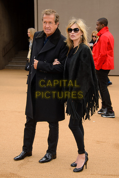 LONDON, ENGLAND - FEBRUARY 23: Mario Testino and Kate Moss attend the Burberry Prorsum AW 2015 Fashion show at Perks Fields, on February 23, 2015 in London, England. <br /> <br /> CAP/JC<br /> &copy;JC/Capital Pictures
