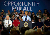 United States President Barack Obama and US Vice President Joe Biden speak to guests at the Community College of Allegheny County on April 16, 2014 in Oakdale, Pennsylvania. The President and Vice President are announcing new federal investments using existing funds to support job-driven training, like apprenticeships, that will expand partnerships with industry, businesses, unions, community colleges, and training organizations to train workers in the skills they need.<br /> Credit: Jeff Swensen / Pool via CNP