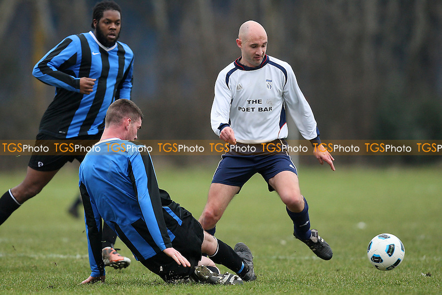 Hackney Borough (blue/black) vs Wounded Knee (white/blue) - Hackney & Leyton League at East Marsh, Hackney Marshes, London - 23/01/11 - MANDATORY CREDIT: Gavin Ellis/TGSPHOTO - Self billing applies where appropriate - Tel: 0845 094 6026