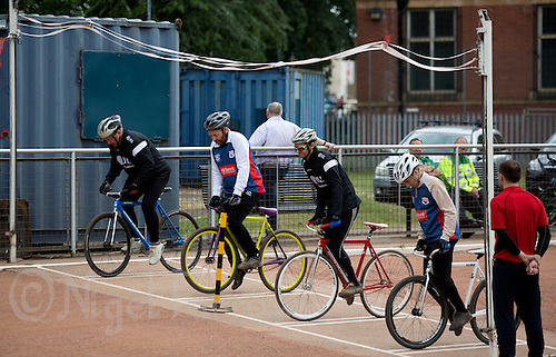 21 JUN 2015 - LONDON, GBR - Ipswich Eagles coach Les Fellgett (second from the left) pushes down hard on the pedals at the start of a heat during the South East League Two cycle speedway fixture against East London at Canning Town Recreation Ground in London, Great Britain (PHOTO COPYRIGHT © 2015 NIGEL FARROW, ALL RIGHTS RESERVED)