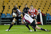 Taiasina Tuifua is tackled by Tom Chamberlain. Air New Zealand Cup rugby game between Counties Manukau Steelers & North Harbour, played at Mt Smart Stadium on August 10th, 2007. The game ended in a 13 all draw.