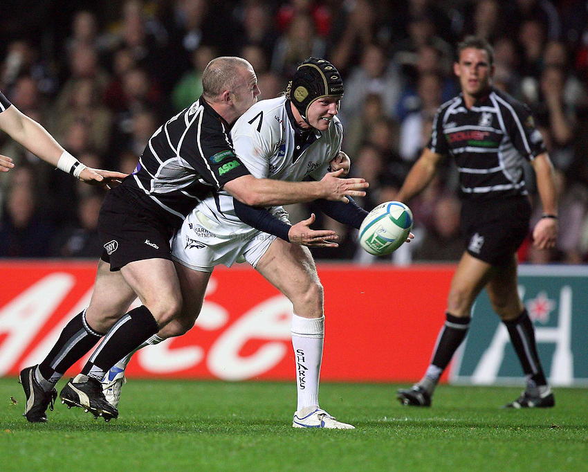Photo: Rich Eaton...Ospreys v Sale Sharks. Heineken Cup. 20/10/2006. Steve Tandy left of Ospreys tackles Sales Marcus Lund