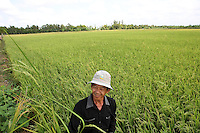 Nguyen Bao Linh in front of his land in Can Tho province, Mekong delta, Vietnam-2010