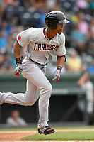 Center fielder Leody Taveras (3) of the Hickory Crawdads runs out a batted ball in a game against the Greenville Drive on Sunday, July 16, 2017, at Fluor Field at the West End in Greenville, South Carolina. Hickory won, 3-1. (Tom Priddy/Four Seam Images)