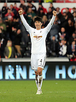 SWANSEA, WALES - FEBRUARY 21: Ki Sung Yueng of Swansea thanks supporters at the end of the Barclays Premier League match between Swansea City and Manchester United at Liberty Stadium on February 21, 2015 in Swansea, Wales.