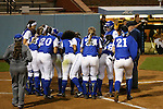 CHAPEL HILL, NC - FEBRUARY 24: Hampton's Kial Watts (above, right) is met at home plate by her teammates after hitting a home run in the bottom of the first inning. The Hampton University Pirates played the Towson University Tigers on February, 24, 2017, at Anderson Softball Stadium in Chapel Hill, NC in a Division I College Softball match. Towson won 17-2 in a five inning run-rule game.