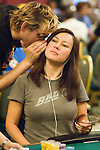 Phil Laak and Jennifer Tilly discuss strategy.