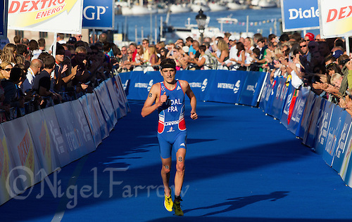 25 AUG 2013 - STOCKHOLM, SWE - Laurent Vidal (FRA) of France finishes the men's ITU 2013 World Triathlon Series round in Gamla Stan, Stockholm, Sweden (PHOTO COPYRIGHT © 2013 NIGEL FARROW, ALL RIGHTS RESERVED)