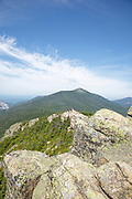 Hikers explore the summit of Mount Liberty in the White Mountains, New Hampshire USA during the summer months.
