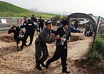 Israeli policeman arresting an ultra Orthodox during a protest against dig tombs in Haifa, on march 6, 2011. Photo by Mahfouz Abu Turk