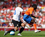 Inter Milan's Adriano challenged by Valencia's Sunny