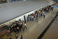 Waiting to board a subway in a New Dlehi Subway station in India