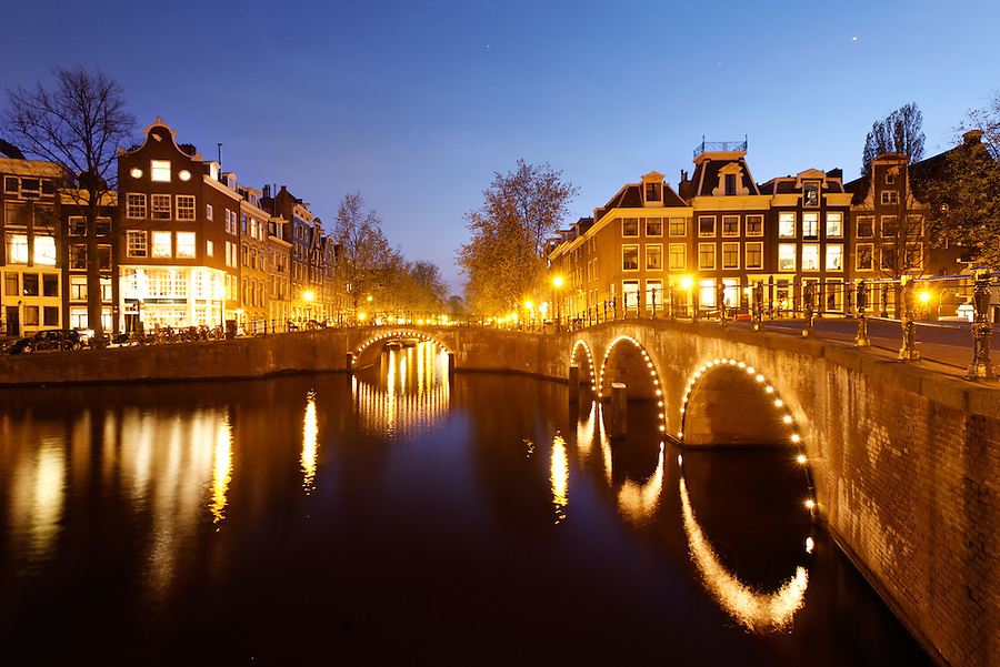 Illuminated canal bridges at night, Amsterdam, Netherlands