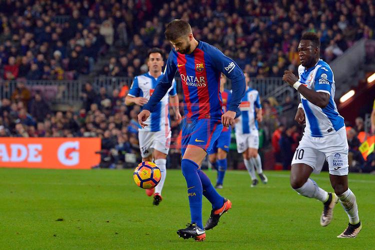 League Santander 2016/2017. Game: 16.<br /> FC Barcelona vs RCD Espanyol: 4-1.<br /> Gerard Pique vs Felipe Caicedo.