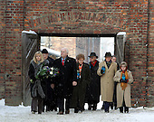 United States Vice President Dick Cheney and his daughter Liz Cheney, left, walk with other members of a United States delegation before paying respects at the The Wall of Death at the Auschwitz-1 Nazi concentration camp, near Krakow, Poland, January 28, 2005. Vice President Cheney was there to take part in ceremonies commemorating the 60th Anniversary of the liberation of the Auschwitz camps.  The Wall of Death was named for its use as the backdrop for firing squads where thousands of prisoners were executed while the camp was in operation. <br /> Mandatory Credit: David Bohrer / White House via CNP