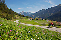 "Day 2 - Near Lenzerheide, flat valley in 3,500 feet climbing. - The author's friend and guide, Horst Hammerschmidt, pedals along an alpine valley in (XXXXX) during day two of their 10-day, 525-mile horseshoe-shaped loop over the country's highest passes. At the top of each climb, the duo rewarded themselves with a scrumptious dessert and dubbed the trip, ""sweet passes."""