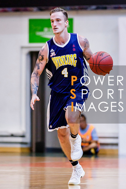 Bullen Christian Matthew #4 of Winling Basketball Club dribbles the ball up court against the Nam Ching during the Hong Kong Basketball League game between Nam Ching vs Winling at Southorn Stadium on May 11, 2018 in Hong Kong. Photo by Yu Chun Christopher Wong / Power Sport Images