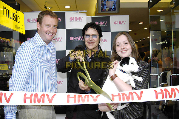SHAKIN' STEVENS.At the Store Opening of HMV Broadstairs, Thanet, Kent, June 14th 2005..half length cutting ribbon scissors dog puppy.Ref: HT.www.capitalpictures.com.sales@capitalpictures.com.©Hugh Thompson/Capital Pictures
