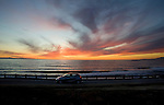 Car driving on Pacifc Coast Higway in Southern California near Santa Barbara at sunset.